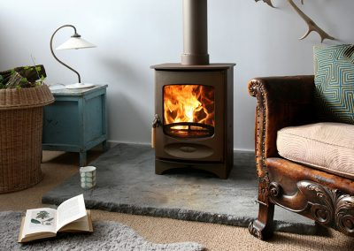 C-Four-woodburning-stove-in-bronze